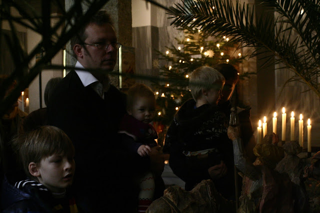 Looking at the nativity scene at the Austrian Church