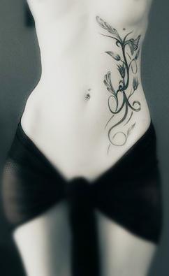 sexy totem flower side tattoo