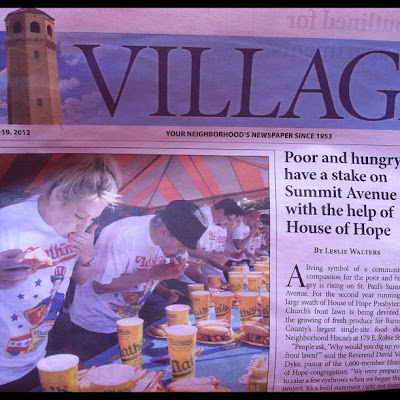 Front page of Highland Villager newspaper with photo of people in an eating contest next to headline about homeless and hungry people