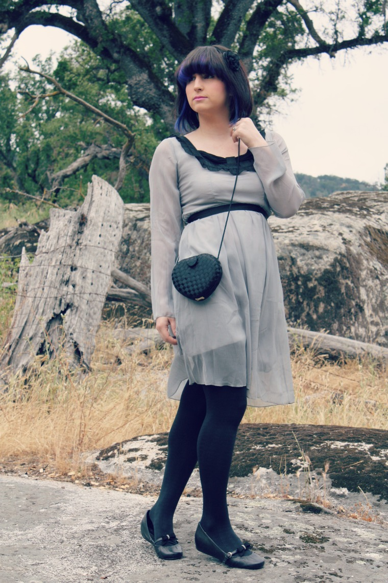 girl with color block black purple hair in vintage dress with heart purse