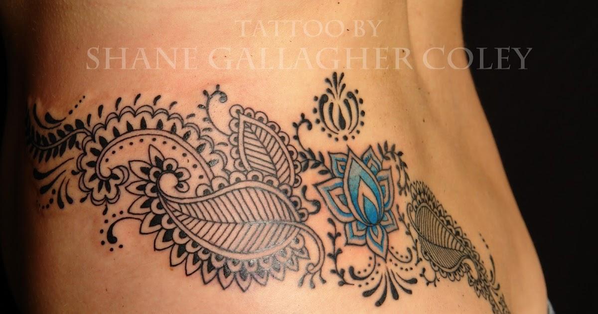 Neck tattoo ideas aryan circle tattoos for Tattoo shops in ocean county nj