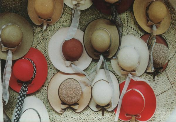 straw hats hanging up