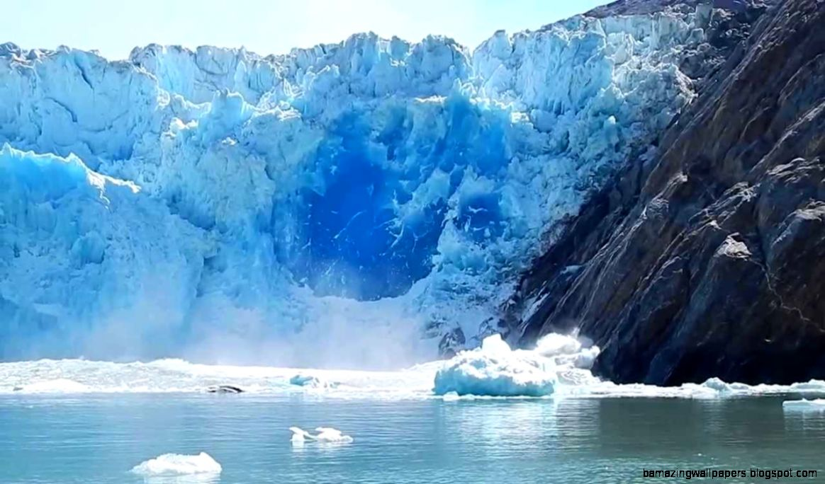 Massive Glacier Calving creating huge blue ice wall   Great event