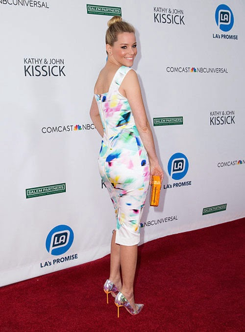 Elizabeth Banks opted to go a completely beauty in a white dress as she headed out to charity event at Los Angeles on Tuesday, September 30, 2014.
