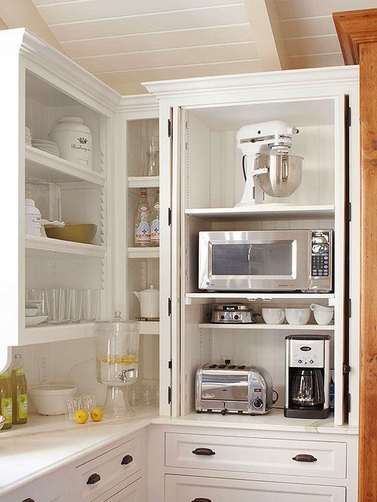 Corner cabinets can be awkward and hard to utilize. A trio of pullout ...