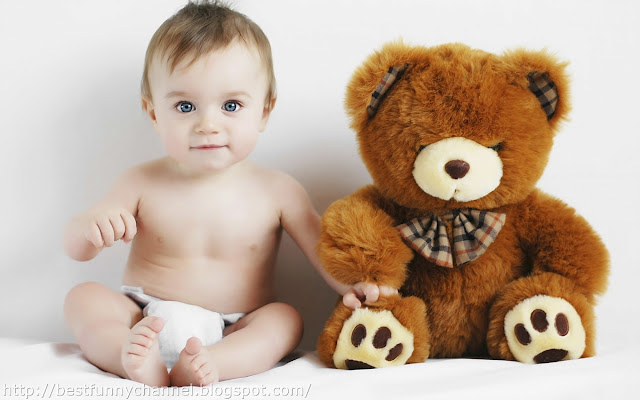 Baby and bear toy.
