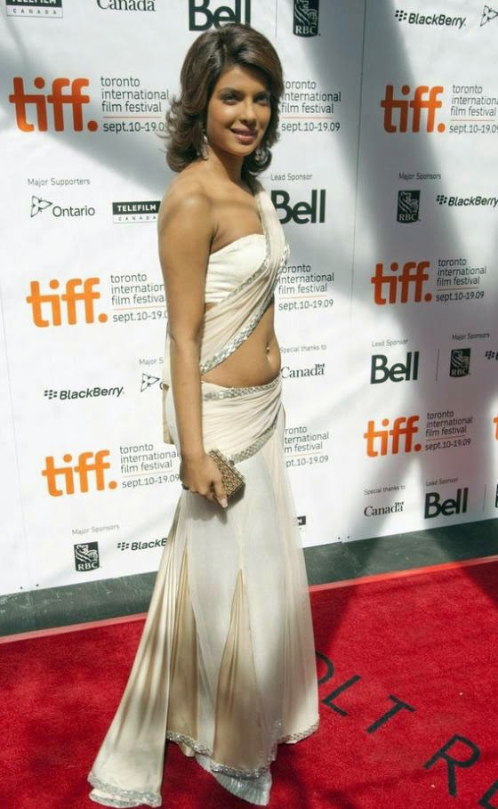 Priyanka Chopra walking the red carpet in white saree