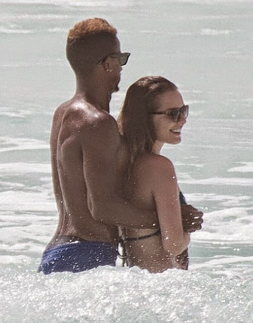 The amazing steps from the perfect balance between the 25-year-old, Helen Flanagan and her fiance, Scott Sinclair going down to the romantic beach fashion in Copacabana, Mexico on Monday, July 7, 2014.