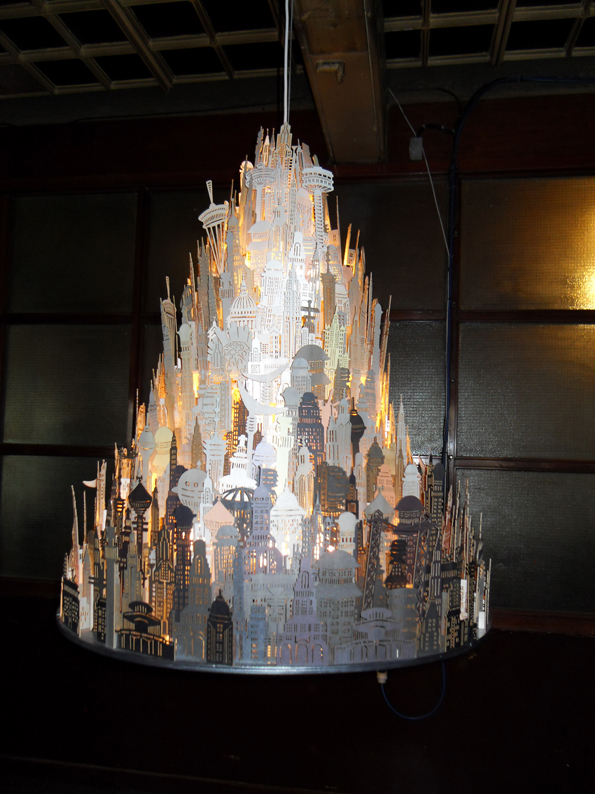 this beautiful light is made of hand and laser cut pieces of