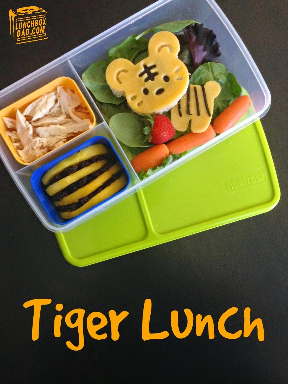 Un papa prépare une Lunch Box Tiger