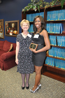 Joy Triplett (l) presents the Sarah Janine Cleary and Michael Griffin Cleary Scholarship to Katrina Caldwell-Russell.