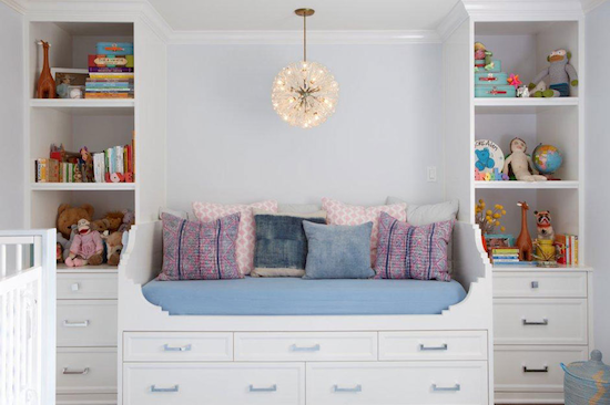 modern nursery, starburst light pendant, built in bookcases and bed