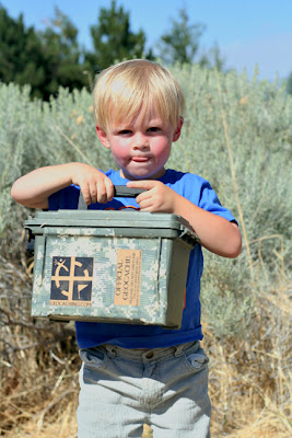 boy holding a geocache