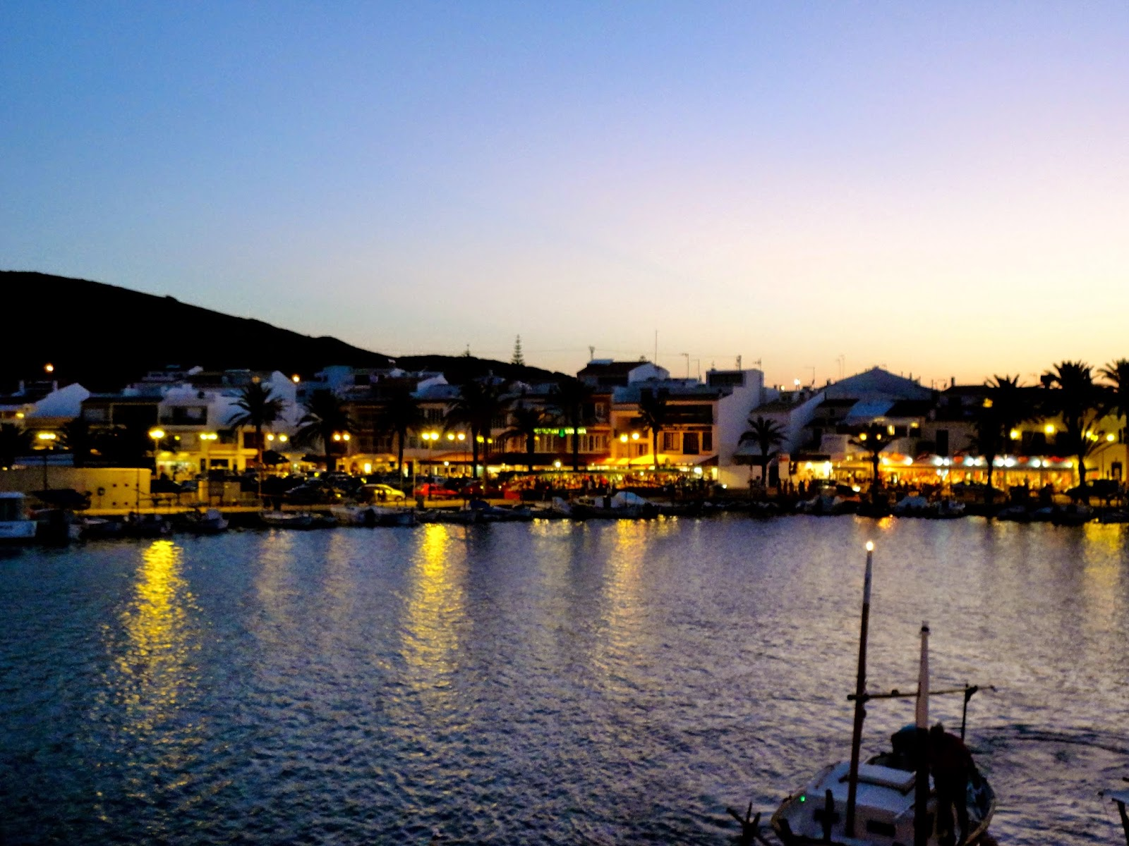 Travel Inspiration | Menorca, Spain | Fornells town lights at night overlooking harbour