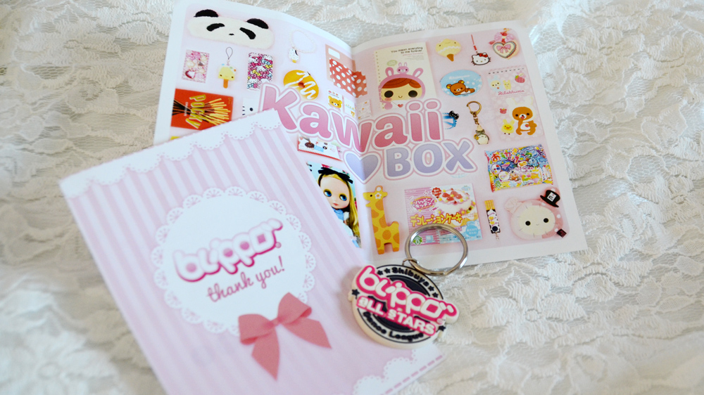 The extra items that Blippo sent, including a kawaii keychain, thank you card, and introductory brochure on their Kawaii Box.