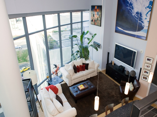 Photo of living room in this small apartment as seen from the stairs