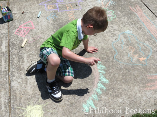 Draw a sidewalk chalk farm for pretend play