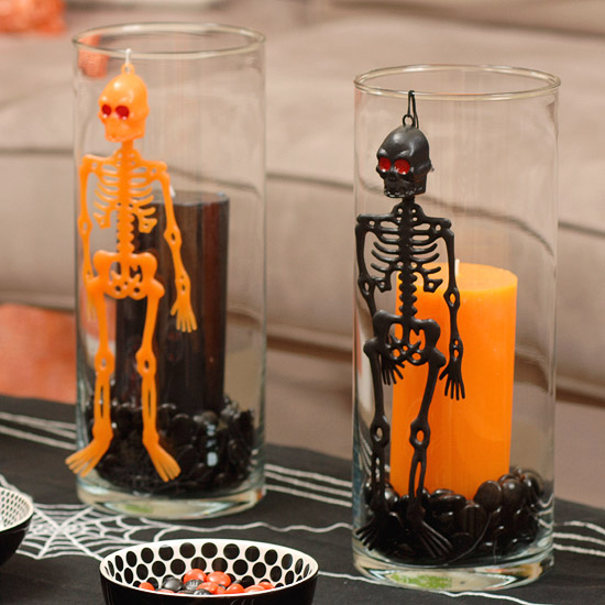 bowl add more orange to this halloween centerpiece editors tip to add more color replace water with black and orange candies or smooth black stones - Halloween Centerpieces