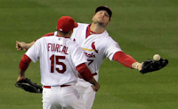 Matt Holliday and Rafael Furcal of the St. Louis Cardinals collide during the fourth inning of Game 6 of the 2011 World Series