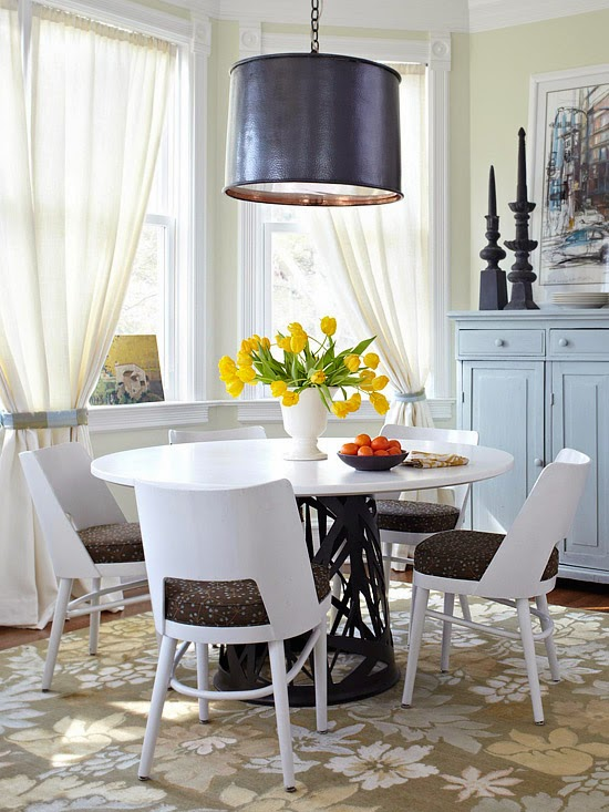 the little details of this breakfast nook tie the room together the patterns on the seat cushions and rug add style to the room the black pendant light breakfast nook lighting ideas