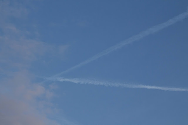 morning sky with clouds and chemtrails