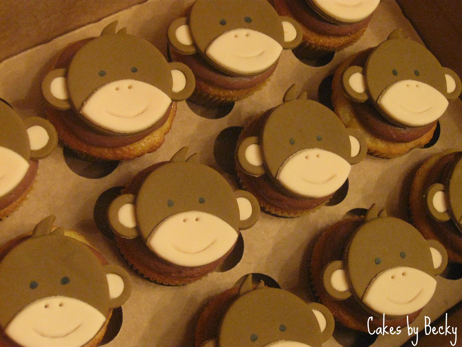 ... hand formed gum paste/fondant monkey toppers for a Baby Shower
