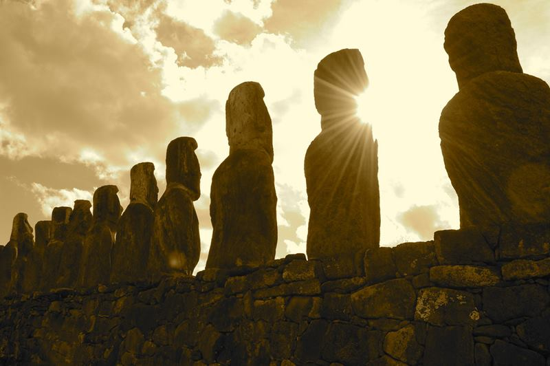 """The Moai, huge sculptures shaped human head, the main tourist attraction of Easter Island. Easter Island has several settlements called Ahu """"Altars"""", where a group of more or less numerous Moai meets, but always perfectly organized and looking in the same direction."""