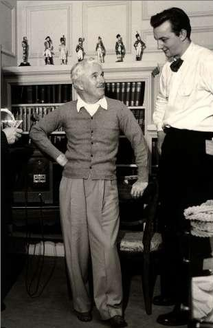 Charlie at his Beverly Hills home, c. 1945. His Oscar is on the bookshelf behind him on the far left.