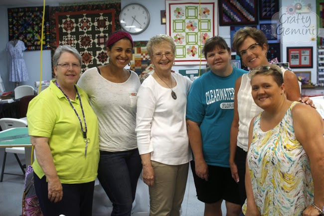 ladies at quilt shop paper piecing class
