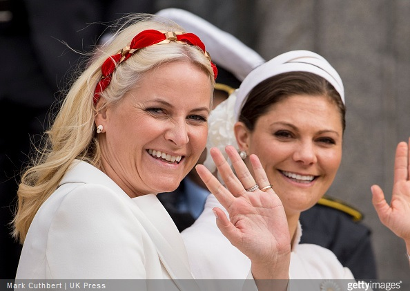 Crown Princess Mette-Marit of Norway and Crown Princess Victoria of Sweden leave the Town Hall after lunch during festivities for the 75th birthday of Queen Margrethe II Of Denmark