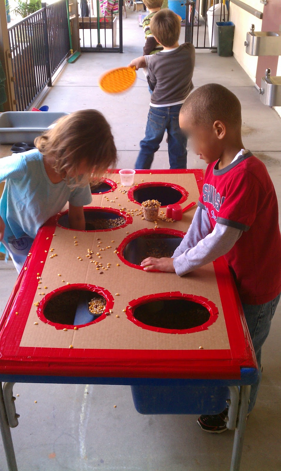 Classroom Ideas For Sensory Integration ~ Exploring the outdoor classroom sensory bin with a hole y top