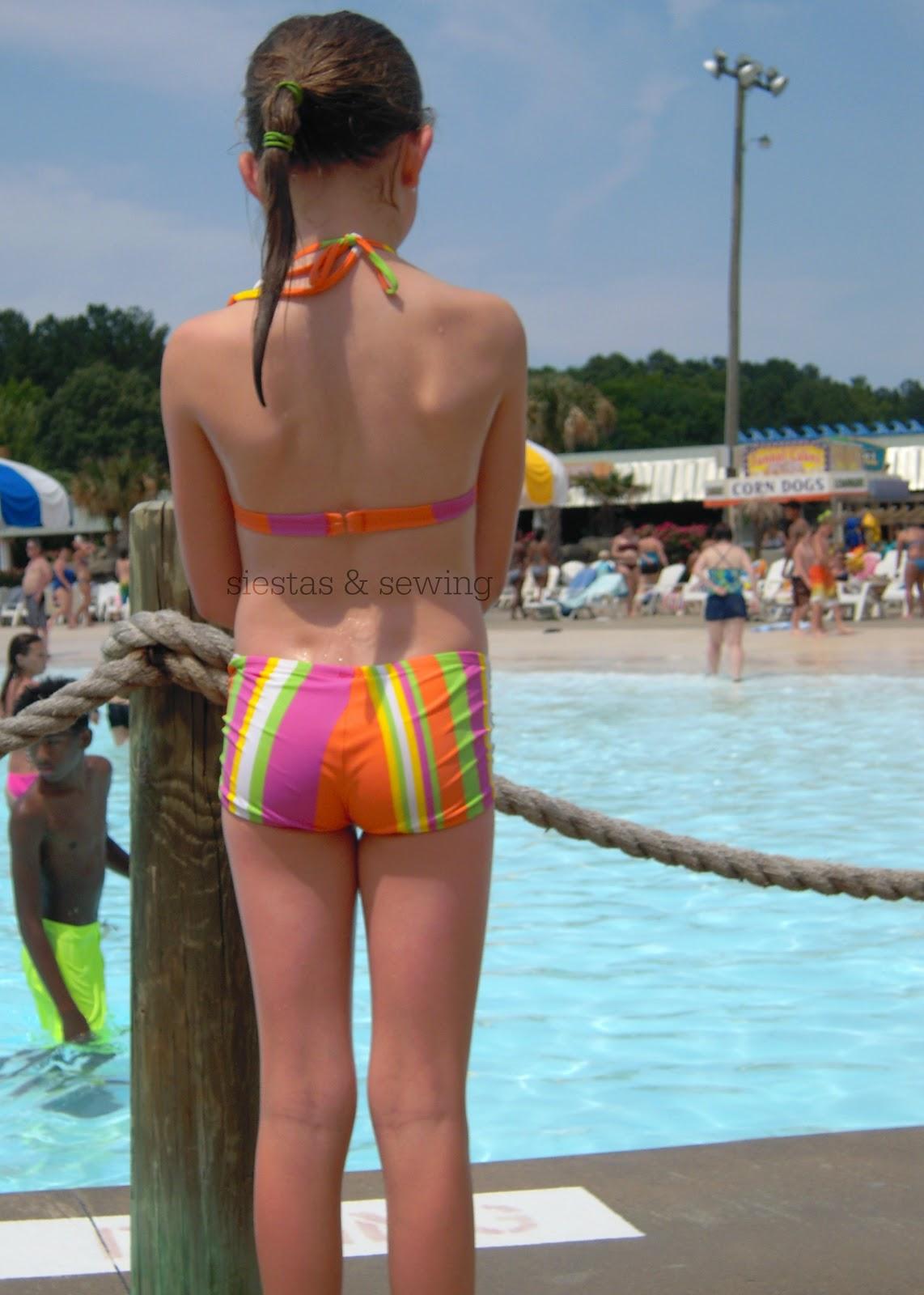chose a bikini with boy shorts and BK chose a one piece with a skirt. stitchtalk.com.