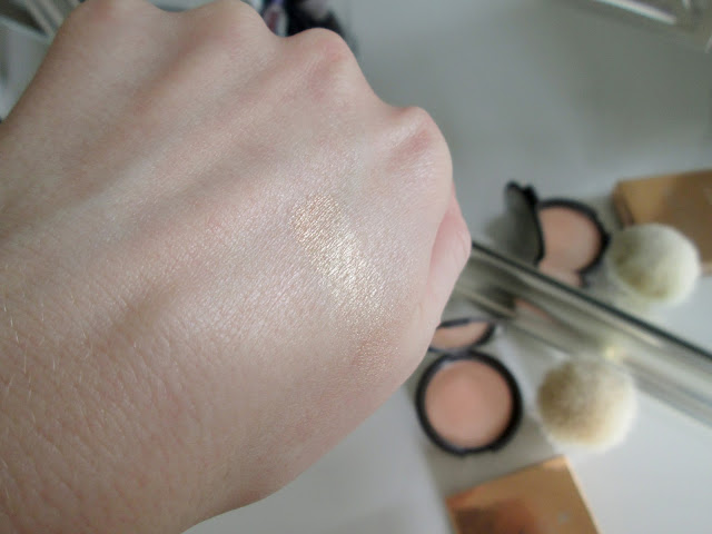 Becca Cosmetics Highlight Powder in the color Champagne Pop applied on face