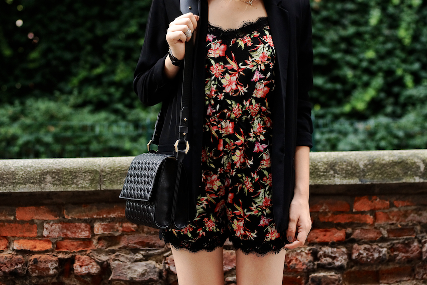 A summer city look featuring a printed playsuit with lace details, wedges and a black chic blazer.