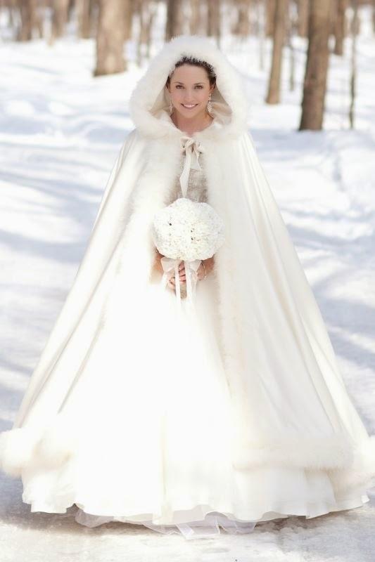 novia invierno con capa