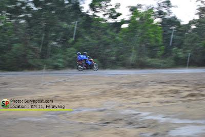 kehujanan dijalan