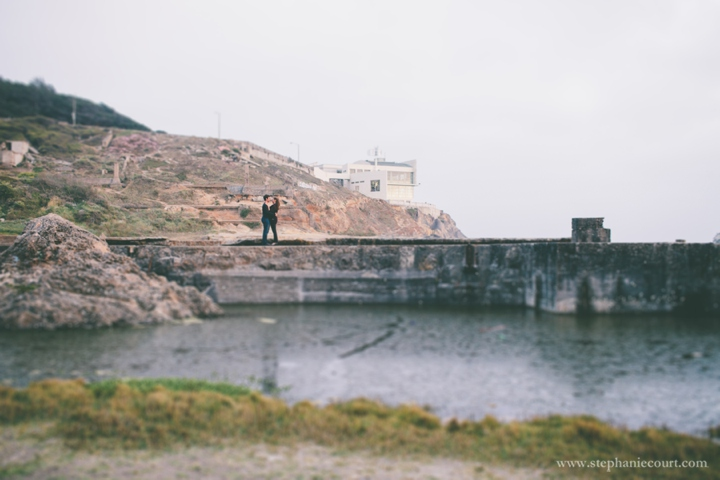 sunset engagement photos at Sutro Baths in San Francisco