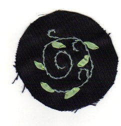 Embroider stem stitch in floss and leaves in silk ribbon