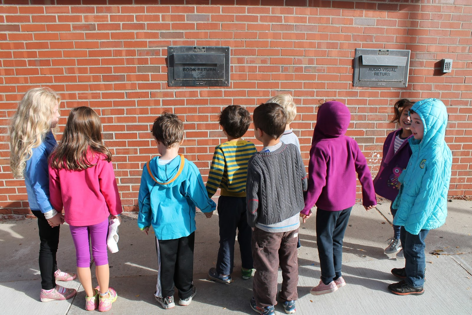Upon Arrival Downtown Kindergartners Dismounted The School Bus Right In Sight Of Night Depository Box For Books And Media Our Own SK Librarian
