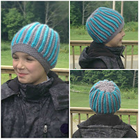 http://www.ravelry.com/patterns/library/ropeish-textured-beanie