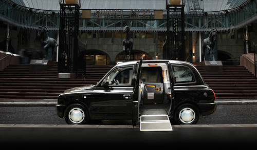 A photo of a London Taxi with wheelchair ramp down.