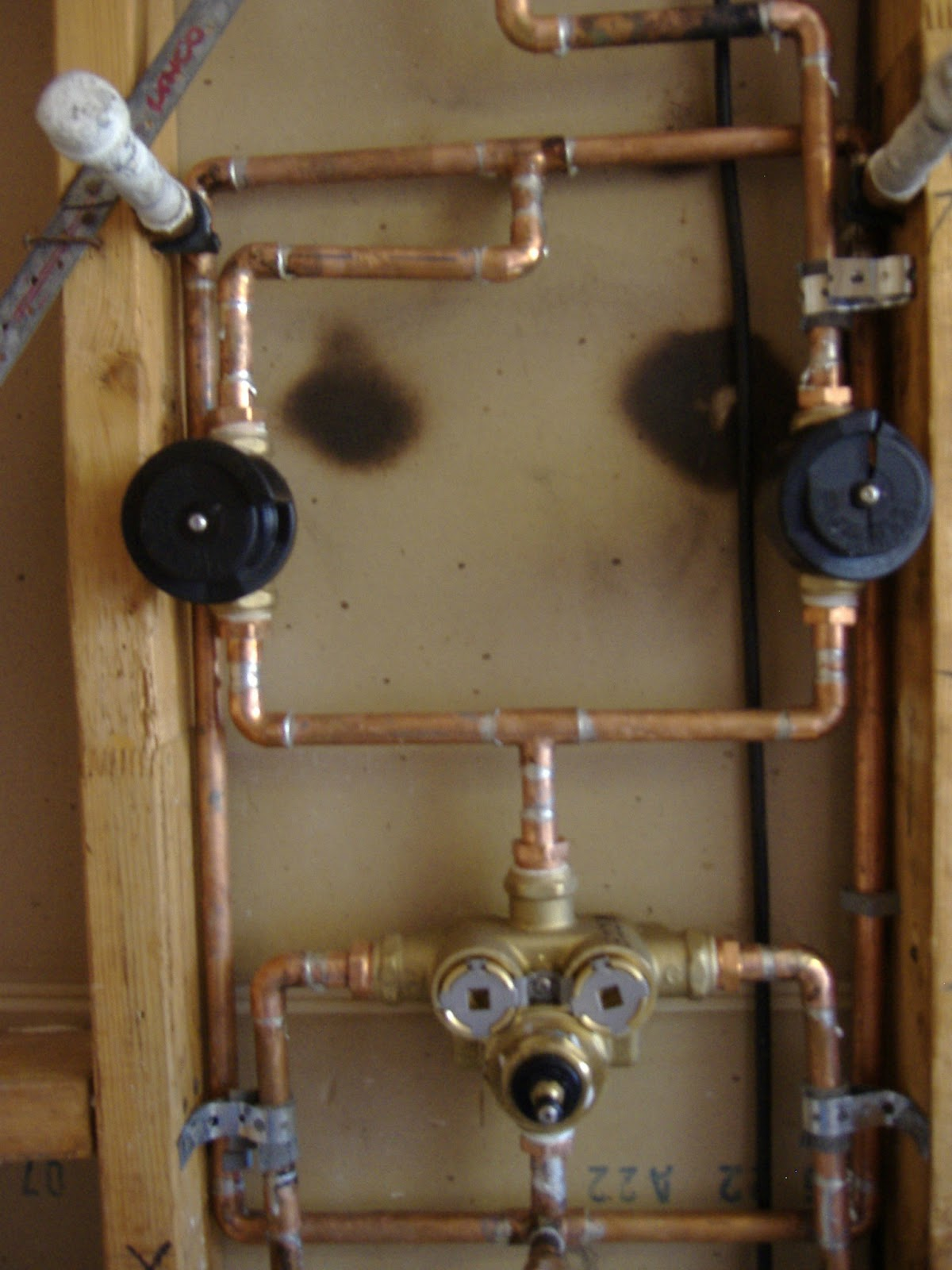 This Shows The Control Valve, The Two Black Valves Are Diverters For The Shower  Head And Three Body Sprayers ( Gray Stubs)