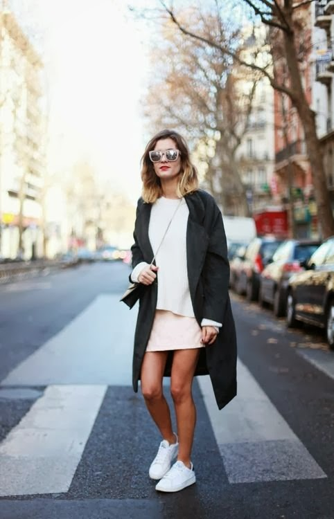 all white ensemble with a statement coat
