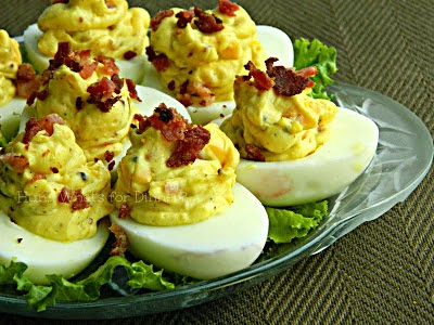 http://www.hunwhatsfordinner.com/2013/04/bacon-cheddar-deviled-eggs-recipe-swap.html