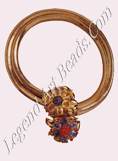 """A gold serpent chain with a """"passepartout"""" clip in yellow and blue faceted Ceylon sapphires and faceted rubies (1939). The clip could be worn alone or with the serpent chain as a necklace, belt or bracelet."""