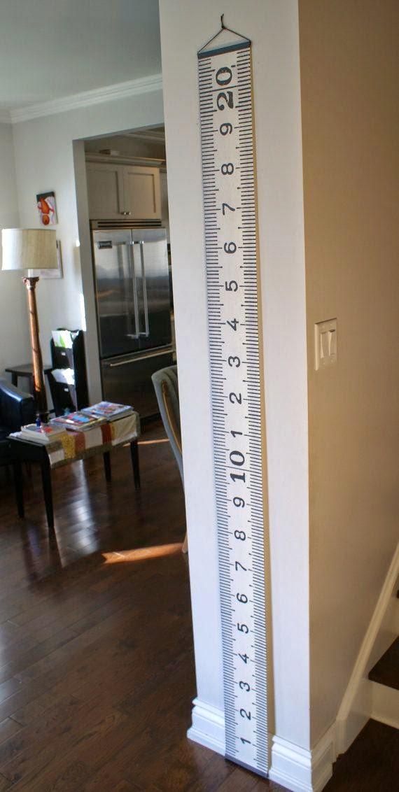 Medidor altura para pared con motivo de cinta métrica