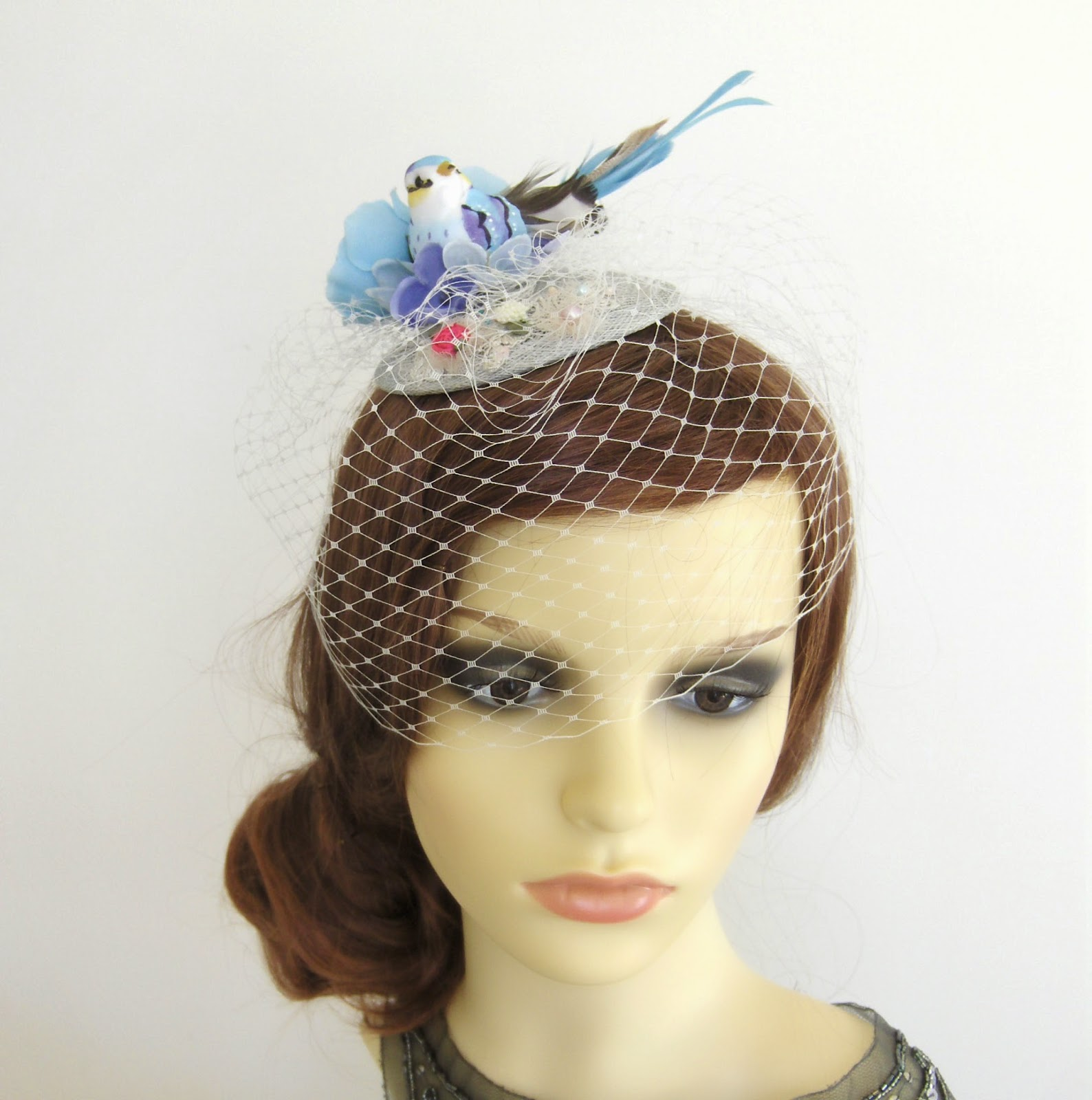 https://www.etsy.com/uk/listing/98542317/blue-bird-fascinator?ref=shop_home_active_8