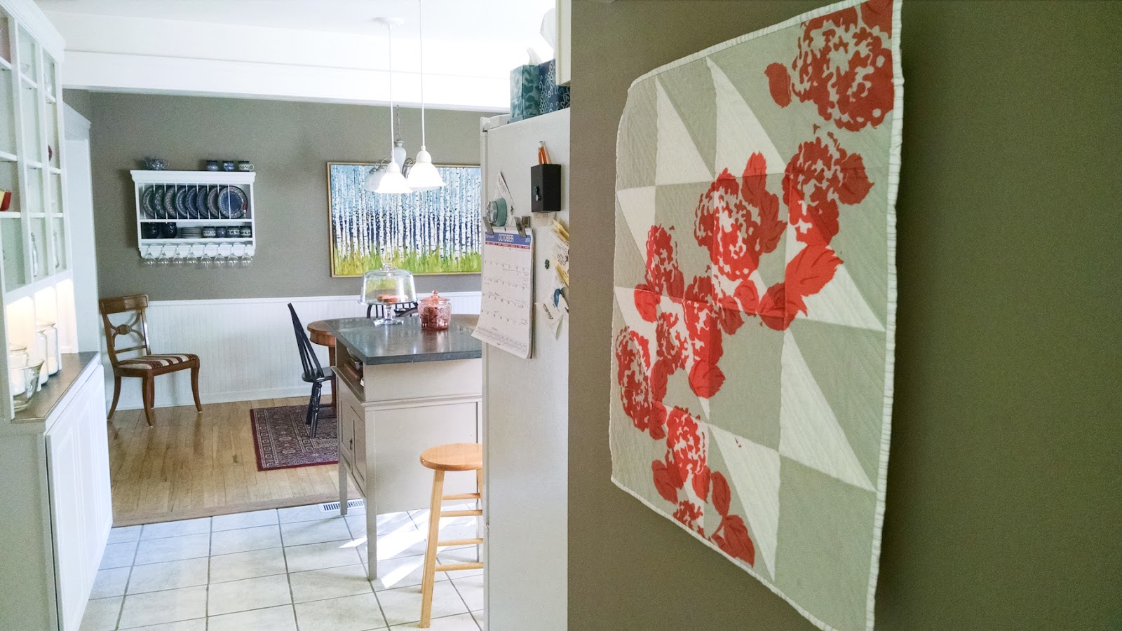New Growth coral modern printed wall quilt living in its Ann Arbor home   by Lovely and Enough