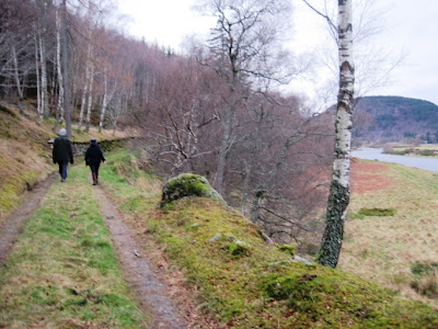 There is view up Deeside from the path around Ballater