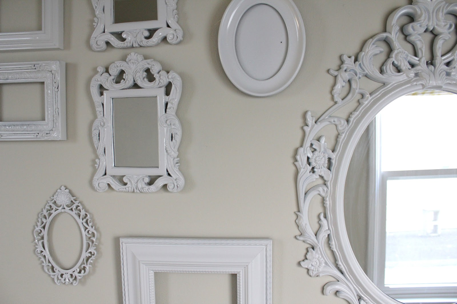 cup half full gallery wall of white ornate frames. Black Bedroom Furniture Sets. Home Design Ideas